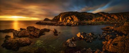 Colorful sunset at rocky coastline of Point of Sleat, Isle of Skye, Scotland Фото со стока