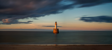 Panorama of Rattray Head Lighthouse in sunset light, east coast of Scotland