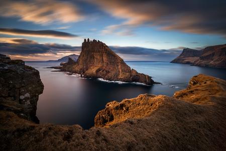 Tindholmur island next to Vagar island in sunset, Faroe Islands