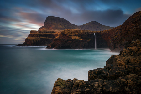 Mulafossur waterfall on Vagar Island in colorful sunset, Faroe Islands