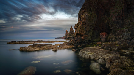 Panorama of Duncanby Head rocks in sunset light, northern Scotland Фото со стока