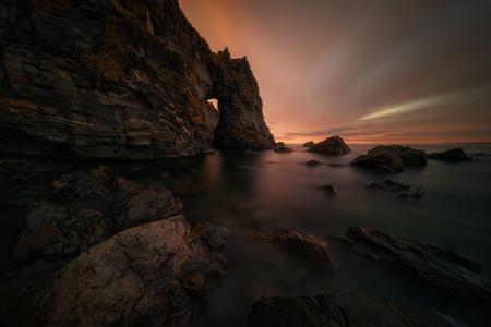 Rocky arch on Aberdour Beach, east coast of Scotland
