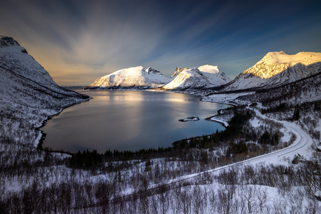 Bergsfjorden and Bergsbotn village among snowy mountains, Senja, Norway