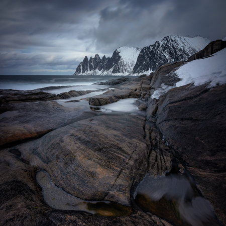 Tugeneset rocky coast with mountains in background, Norway