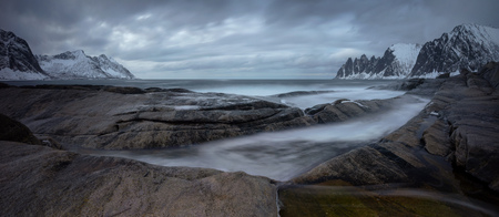 Panorama of Tugeneset rocky coast with mountains in background, Senja, Norway