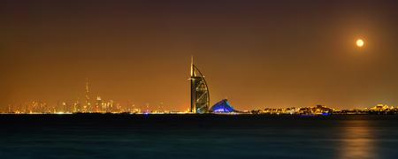 Night panorama of Dubai with Burj Al Arab Hotel, United Arab Emirates