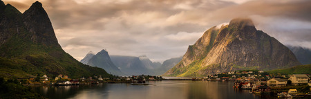 Reine village and fjord among mountains of Moskenesoya, Lofoten Фото со стока
