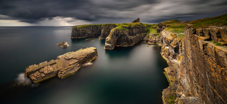 Panorama of Old Wick Castle on high cliffs in stormy weather, Scotland
