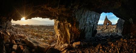 Panorama of the caves on Playa de Campiecho rocky coast at sunset, Asturias, Spain