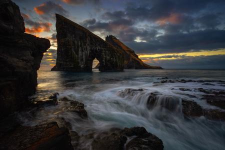 Drangarnir rocky arch on Vagar island in sunset, Faroe Islands