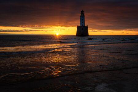 Rattray Head Lighthouse in sunrise light, east coast of Scotland Фото со стока