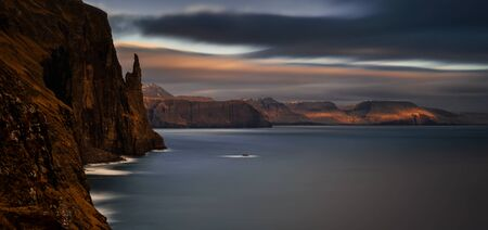 Panorama of Witch Finger rock and cliffs in sunset light, Faroe Islands Фото со стока