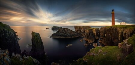 Panorama of Butt of Lewis lighthouse on high cliffs in sunset light, Scotland Stockfoto - 130893403