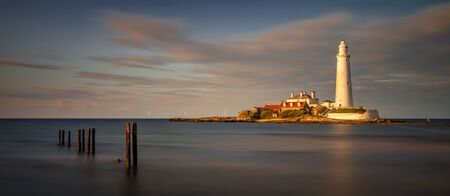 Panorama of St. Marys Lighthouse coast in sunset, Great Britain