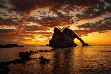 Bow Fiddle Rock in colorful sunrise light, Portknockie, Scotland