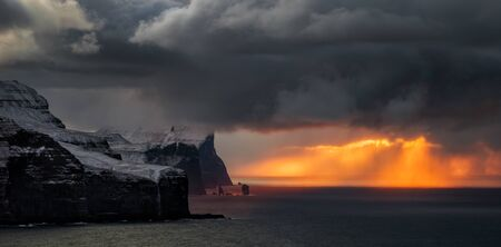 Panorama of Streymoy and Eysturoy cliffs in sunset light, Faroe Islands