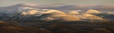 Winter panorama of Karkonosze mountains in sunset light, Poland