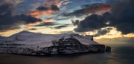 Panorama of cliffs of Stakkur on Streymoy Island in sunset light, Faroe Islands