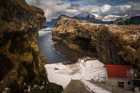 Little harbour of Gjogv village between sharp cliffs, Faroe Islands