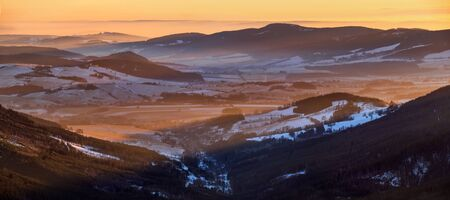 Winter panorama of Morava Valley from Snieznik summit in sunset light Banque d'images