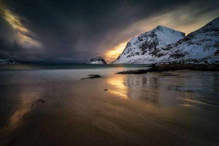Dramatic winter sunset on Haukland Beach, Lofoten
