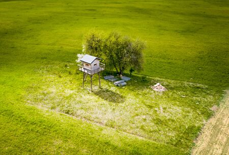 High seat on green meadow on Mazuras, Poland