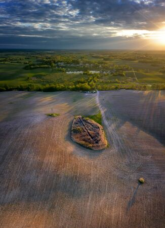 Fields of Mazury in sunset light from drone, Poland Banque d'images