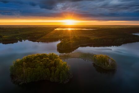 Two islands on Gromskie Lake in Mazuras in sunset light, Poland