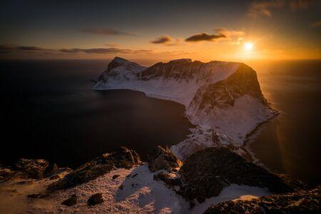 Mountain ridge of Vaeroy island at snowy winter in sunset, Lofoten Stockfoto - 150135865