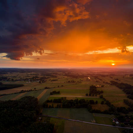 Beautiful sunset over Wolka Grochowa village, Kurpie, Poland Stockfoto