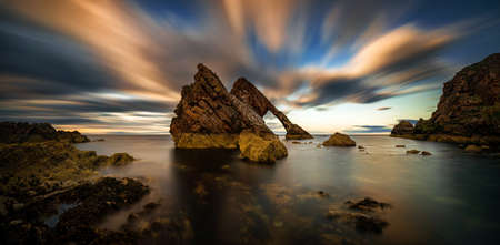 Panorama of Bow Fiddle Rock formations in dusk, Portknockie, Scotland