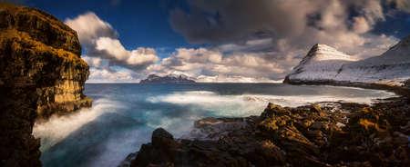 Gjogv village coastline with Kalsoy island in background, Faroe Islands