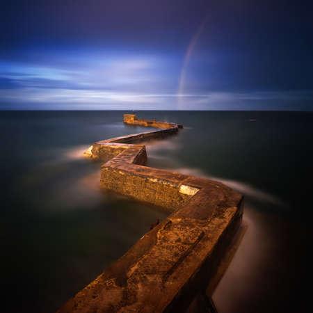 Rainbow over zig zag pier in St. Monans village, east coast of Scotland