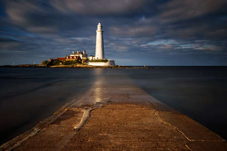 St. Mary's Lighthouse and pier in sunset, Great Britain