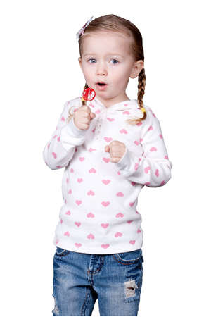 lolli: Ayoung girl with a lolli pop.  The image is isolated. Stock Photo