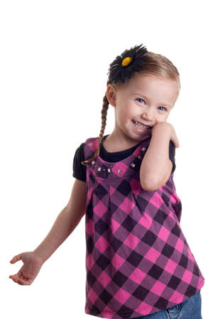 shy girl: A happy and shy girl standing with a smile on her face.  The image is isolated on white.