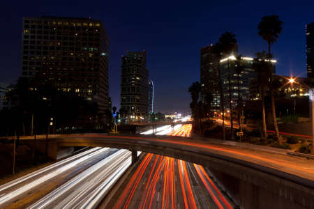 trafic: A photograph of the night blue sky of Los Angeles California.  The trafic is streaking across the roads. Stock Photo
