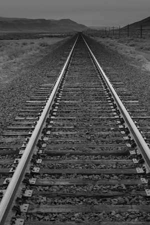 rule of thirds: A photograph of a long railroad.  The vanishing point leads the eye through the photograph. Stock Photo