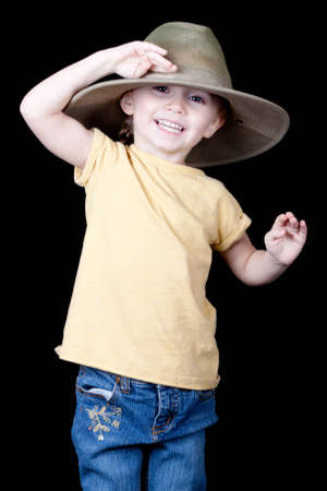 A girl is saluting with her oversized hat.  She is saying Aye Mate!