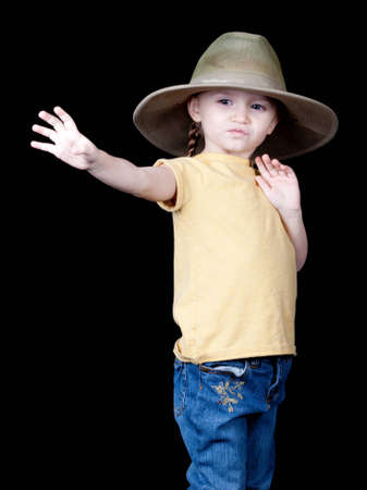 oversized: A beautiful young girl in an oversized hat.  She is reaching out for something, or could be dropping something.
