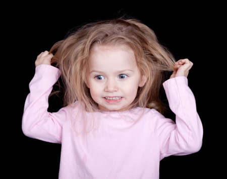 silliness: A girl pulling out her hair out of frustration.  She looks like she is going crazy.