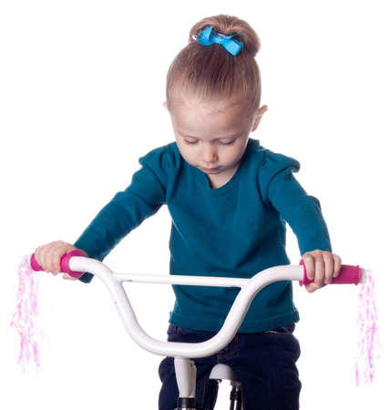 A girl is sad because she has no friends to ride her bike with. photo
