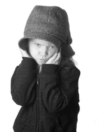 A black and white isolation of a girl that is hiding her face. Stock Photo - 9274793