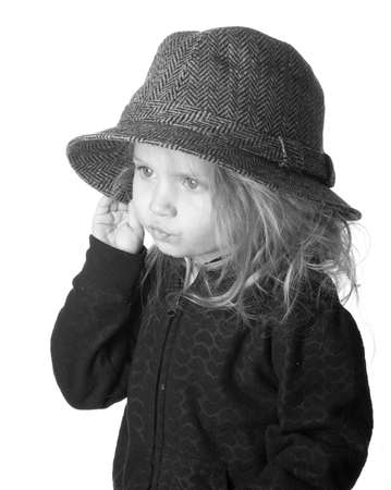 This little miss is gazing off.  A black and white photograph. Stock Photo - 9274791