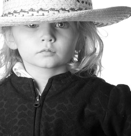rule of thirds: A cute but serious cowgirl is photographed using the rule of thirds.