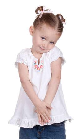 A girl holds back a little, she is slightly shy. Standard-Bild