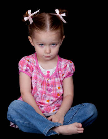 mood moody: A photograph of a young child who is sad and depressed Stock Photo