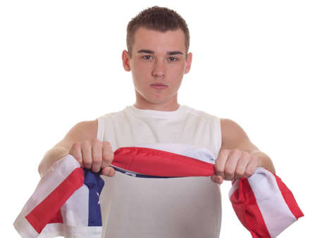 An isolation of an athletic young man holding an american flag. photo