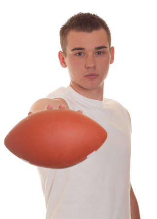 An isolation of an athletic young man holding a football photo