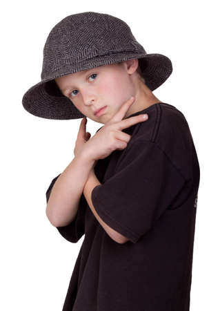 A photograph of a young boy with his arms crossed and holding a pease sign with his hands while wearing a grey hat. Stock Photo - 9501427